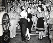 view [Groucho Marx and Veronica Lake entertaining the troops : black-and-white photoprint] digital asset: [Groucho Marx and Veronica Lake entertaining the troops : black-and-white photoprint]