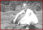 view [Groucho Marx in the yard of his house, Great Neck, New York] [film frame] digital asset: [Groucho Marx in the yard of his house, Great Neck, New York] [film frame]