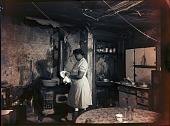 view [Woman washing or drying dishes: black-and-white photonegative.] digital asset: [Woman washing or drying dishes: black-and-white photonegative.]