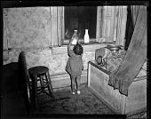 view [Little girl taking bottle from windowsill, photonegative.] digital asset: [Little girl taking bottle from windowsill, photonegative.]