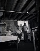 view [Domestic interior with African American woman and two children : black-and-white photonegative.] digital asset: [Domestic interior with African American woman and two children : black-and-white photonegative.]