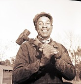 view [Smiling African American man with sledgehammer : photonegative.] digital asset: [Smiling African American man with sledgehammer : photonegative.]