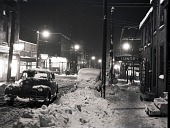 view [Snowy evening street scene with car on the road; probably Pittsburgh : photonegative.] digital asset: [Snowy evening street scene with car on the road; probably Pittsburgh : photonegative.]