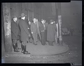 view [Group of men and two policemen on street : photonegative.] digital asset: [Group of men and two policemen on street : photonegative.]