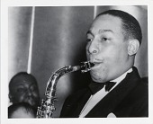view [Johnny Hodges playing saxophone at the Savoy Ballroom : black-and-white photoprint.] digital asset: [Johnny Hodges playing saxophone at the Savoy Ballroom : black-and-white photoprint.]