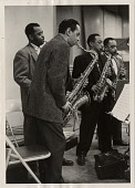 view [Left to right: Paul Gonsalves, Jimmy Hamilton, Johnny Hodges, Russell Procope, all playing saxophones : black-and-white photoprint,] digital asset: [Left to right: Paul Gonsalves, Jimmy Hamilton, Johnny Hodges, Russell Procope, all playing saxophones : black-and-white photoprint,] 1956.