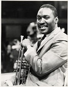 view [Herbie Jones holding trumpet : black-and-white photoprint.] digital asset: [Herbie Jones holding trumpet : black-and-white photoprint.]