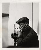 view [Ellington band member holding a trumpet : black-and-white photoprint.] digital asset: [Ellington band member holding a trumpet : black-and-white photoprint.]