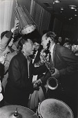 view [Duke Ellington shaking hands with a Russian musician holding a saxophone : black-and-white photoprint,] digital asset: [Duke Ellington shaking hands with a Russian musician holding a saxophone : black-and-white photoprint,] 1971.