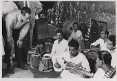 view [Duke Ellington with group of Indian musicians, India : black-and-white photoprint.] digital asset: [Duke Ellington with group of Indian musicians, India : black-and-white photoprint.]