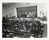 view [Duke Ellington and orchestra on stage in Baghdad, Iraq during 1963 State Department Tour : black-and-white photoprint.] digital asset: [Duke Ellington and orchestra on stage in Baghdad, Iraq during 1963 State Department Tour : black-and-white photoprint.]