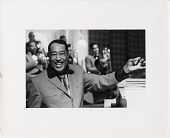 view [Duke Ellington with a big smile, conducting while seated at the piano, Claremont Hotel, Berkeley, California, Sept 1970, taken by Margot E. Page from Mill Valley, California [black-and-white photoprint.] digital asset: [Duke Ellington with a big smile, conducting while seated at the piano, Claremont Hotel, Berkeley, California, Sept 1970, taken by Margot E. Page from Mill Valley, California [black-and-white photoprint.]