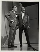 view [Duke Ellington with Ed Sullivan onstage during the Ed Sullivan Show : black-and-white photoprint.] digital asset: [Duke Ellington with Ed Sullivan onstage during the Ed Sullivan Show : black-and-white photoprint.]