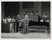view [Duke Ellington with Peggy Lee onstage during the Ed Sullivan Show : black-and-white photoprint.] digital asset: [Duke Ellington with Peggy Lee onstage during the Ed Sullivan Show : black-and-white photoprint.]