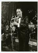 view [Duke Ellington at microphone, West Germany : black-and-white photoprint.] digital asset: [Duke Ellington at microphone, West Germany : black-and-white photoprint.]