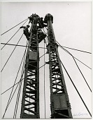 "view Preparing to jump the derrick two stories up on the Empire State Building--1930 [photoprint] digital asset: ""Preparing to jump the derrick two stories up"""