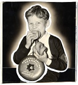view [Boy with Doughnut Eating Champion award, Boys' Club, October 1938 : black-and-white photoprint] digital asset: [Boy with Doughnut Eating Champion award, Boys' Club, October 1938 : black-and-white photoprint].