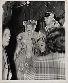 view [Lucille Ball eating a doughnut while in costume : black and white photoprint] digital asset: [Lucille Ball eating a doughnut while in costume : black and white photoprint ca. 1950-1960].