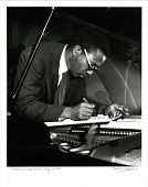 view Thelonious Monk [making notes at the piano]. [Photoprint, black-and-white digital asset: Monk, Thelonious; Minton's Playhouse, Harlem, New York City, 1949