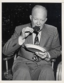 view [Dwight Eisenhower eating an ice cream bar : black-and-white photoprint] digital asset: [Dwight Eisenhower eating an ice cream bar : black-and-white photoprint].