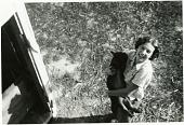 view [Adina Via holding piglet, Via Farm, Prince George County, Maryland : black-and-white photoprint] digital asset: [Adina Via holding piglet, Via Farm, Prince George County, Maryland : black-and-white photoprint, 1955.]