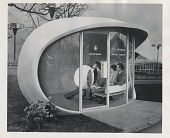 view [Two couples in futuristic family telephone booth at the New York World's Fair, 1939 : black and white photoprint] digital asset: [Two couples in futuristic family telephone booth at the New York World's Fair, 1939 : black and white photoprint].
