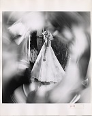 view [Fashion photograph of a Priscilla of Boston wedding gown : black and white photoprint] digital asset: [Fashion photograph of a Priscilla of Boston wedding gown : black and white photoprint].