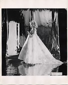 view [Fashion photograph of a Priscilla of Boston wedding gown : black-and-white photoprint] digital asset: [Fashion photograph of a Priscilla of Boston wedding gown : black-and-white photoprint].