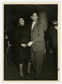 "view [Ella Fitzgerald and Dizzy Gillespie at ""The Penguin Club,"" Oslo, Norway, February 17, 1956.] [Black-and-white photoprint.] digital asset: [Ella Fitzgerald and Dizzy Gillespie at ""The Penguin Club,"" Oslo, Norway, February 17, 1956.] [Black-and-white photoprint.]."