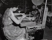 view [Woman factory worker at her job station : black-and-white photoprint.] digital asset: [Woman factory worker at her job station : black-and-white photoprint.]