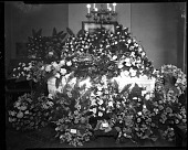 view [Casket blanketed with flowers : black-and-white cellulose acetate photonegative] digital asset: [Casket with flowers] [cellulose acetate photonegative].