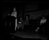 view [Woman speaking to audience at lectern] [cellulose acetate photonegative] digital asset number 1