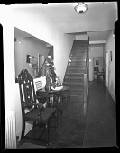 view [Interior view of foyer, hallway, and stairway] [cellulose acetate photonegative] digital asset: [Interior view of foyer and stairway] [cellulose acetate photonegative].