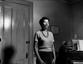 view [Woman singing near piano : cellulose acetate photonegative.] digital asset: [Woman singing near piano : cellulose acetate photonegative.]