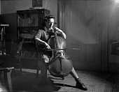 view [Woman and cello, Howard University : black-and-white photonegative.] digital asset: [Woman and cello, Howard University : black-and-white photonegative.]