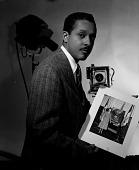 view [Robert Scurlock publicity portrait : black-and-white photonegative.] digital asset: [Robert Scurlock publicity portrait : black-and-white photonegative.]