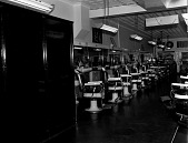 view Ewell's Barber Shop [interior] [black-and-white photonegative] digital asset: Ewell's Barber Shop [interior] [black-and-white photonegative].