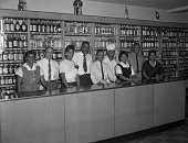 view Charles Jackson liquor store employees [interior] [black-and-white photonegative] digital asset: Charles Jackson liquor store employees [interior] [black-and-white photonegative].