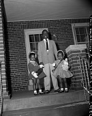 view [Older boy and two girls on porch] digital asset: [Older boy and two girls on porch]