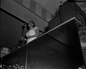 view Billie Holiday [onstage, singing at microphone, looking up at stage from a low angle] [cellulose acetate photonegative] digital asset: Billie Holiday [onstage, singing at microphone, looking up at stage from a low angle] [cellulose acetate photonegative].