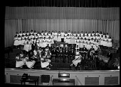 view Scurlock Studio Records, Subseries 4.4: Black and white negatives in freezer storage arranged by subject digital asset: Cardozo High School Orchestra and Chorus, May, 1960 [cellulose acetate photonegative].