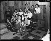 view Mrs. Stanley Gimble [grandchildren's party, December 24, 1957 : cellulose acetate photonegative] digital asset: Mrs. Stanley Gimble [grandchildren's party, December 24, 1957 : cellulose acetate photonegative].