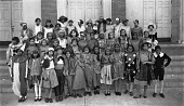 view [Group of boys and girls in costumes posing on exterior steps, ca. 1930 : cellulose acetate photonegative, banquet camera format] digital asset: [Group of boys and girls in costumes posing on exterior steps, ca. 1930 : cellulose acetate photonegative, banquet camera format].