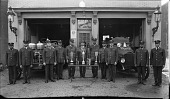 view [Group of firemen in uniform outside the firehouse for Engine Company No. 4, ca. 1930 : cellulose acetate photonegative, banquet camera format] digital asset: [Group of firemen in uniform outside the firehouse for Engine Company No. 4, ca. 1930 : cellulose acetate photonegative, banquet camera format].