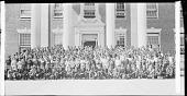 view [Group of young men and women, possibly students, standing in rows in front of an unidentified building exterior : cellulose acetate photonegative, banquet camera format] digital asset: [Group of young men and women, possibly students, standing in rows in front of an unidentified building exterior : cellulose acetate photonegative, banquet camera format].