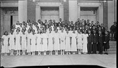view [Group of boys and girls standing on the exterior steps of an unidentified building : cellulose acetate photonegative, banquet camera format] digital asset: [Group of boys and girls standing on the exterior steps of an unidentified building : cellulose acetate photonegative, banquet camera format].