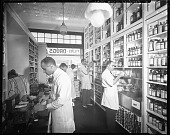 view Pinkett's Drug Store, '39 [interior with five pharmacists: cellulose acetate photonegative] digital asset: Pinkett's Drug Store, '39 [interior with five pharmacists: cellulose acetate photonegative].