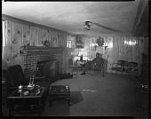 view Mr. John Rhine's Home, 1938 [man seated in a room : cellulose acetate photonegative] digital asset: Mr. John Rhine's Home, 1938 [man seated in a room : cellulose acetate photonegative].