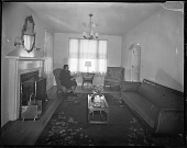 view Mr. John Rhine's Home, 1938 [woman seated in a room : cellulose acetate photonegative] digital asset: Mr. John Rhine's Home, 1938 [woman seated in a room : cellulose acetate photonegative].