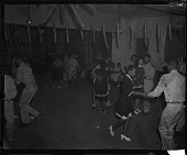 view [Group of men in military uniform dancing with women : cellulose acetate photonegative] digital asset: [Group of men in military uniform dancing with women : cellulose acetate photonegative].